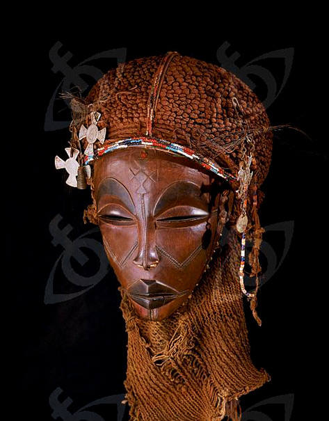 Dance-mask-of-a-type-known-as-Mwana-Pwo-regarded-as-an-idealised-depiction-of-a-beautiful-young-girl-showing-facial-scarifications